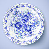 Blue plate with floral ornament in gzhel style
