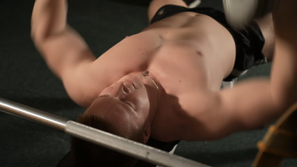 Healthy muscular young man engaged in bodybuilding