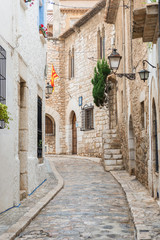Medieval street in Sitges old town, Spain