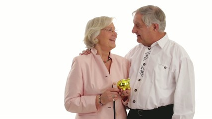 Couple of senior citizen with piggy bank