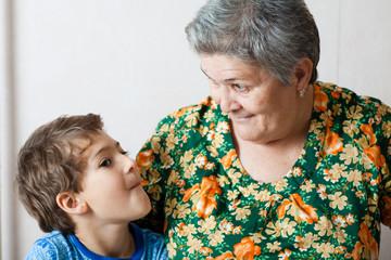 grandma and grandson indoors