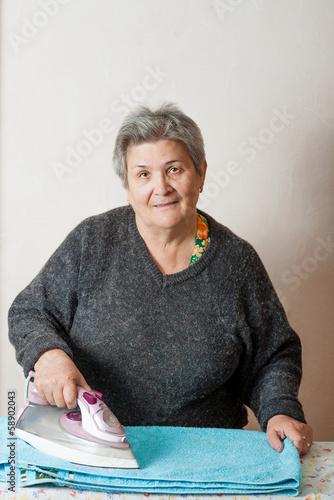 senior women iron clothes