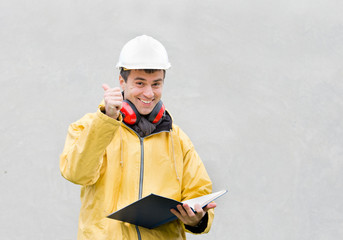 Satisfy engineer holds his thumb up and smiles