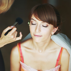 Bride having wedding make-up