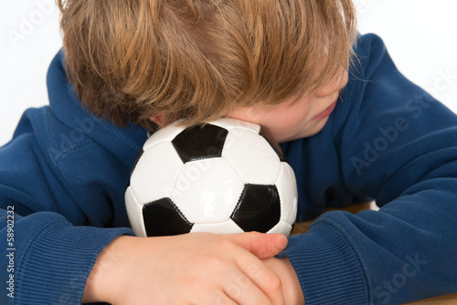 boy with ball is sleeping
