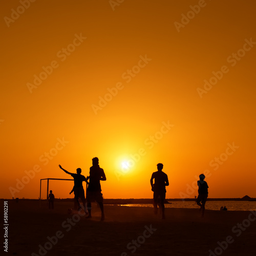 Amateurs playing football at Jumeira beach in Dubai
