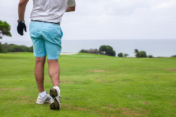 Close-up of a man playing golf
