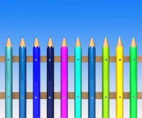 Colorful pencils on sky background