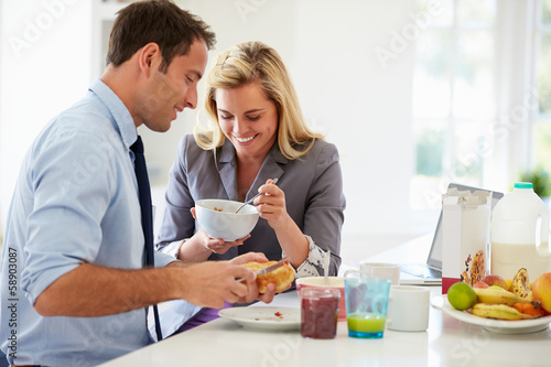 Couple Having Breakfast Together Before Leaving For Work