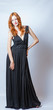 redhead full body in black dress,studio shot