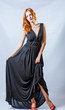 redhead full body in black dress, studio shot