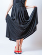 redhead waist down body in black dress,studio shot