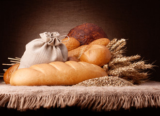Bread, flour sack and ears bunch still life