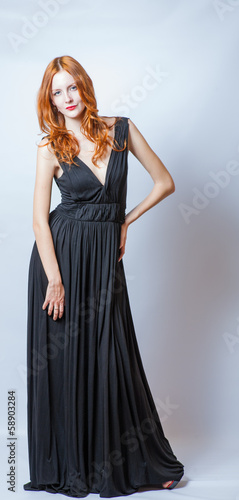 redhead full body in black dress,studio shot