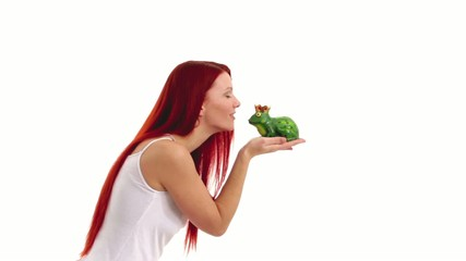 Woman kissing a frog.