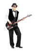 Full length portrait of a person playing a bass guitar