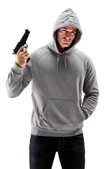 Young male with hood over his head holding a gun