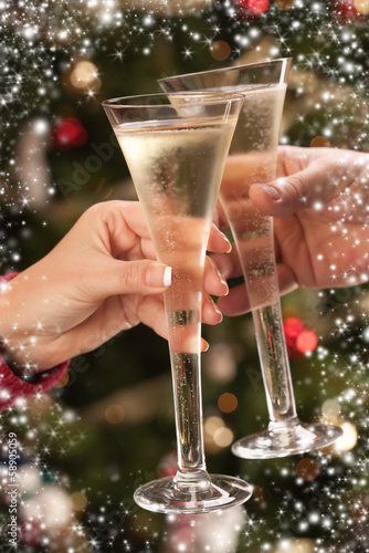 Man and Woman Toasting Champagne in Front of Lights