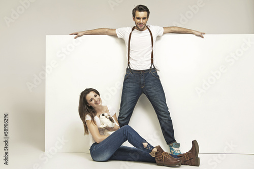 Picture of young attractive couple with rabbit
