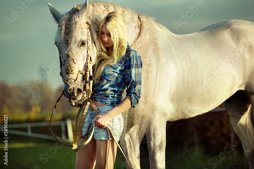 Portrait of a beauty blondie with horse