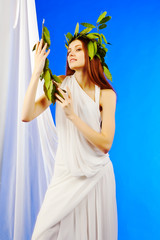 woman wearing green roman laurel wreath