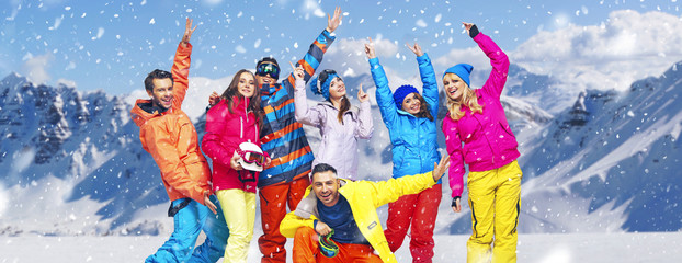 Panoramic photo of cheerful snowboarders