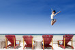 Active girl jump over beach chairs