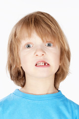 Boy with Blond Hair Showing his Missing Milk Teeth
