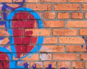 Graffiti on brick wall, background.