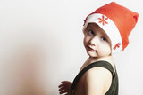 little boy in red Santa hat.Christmas.your text here