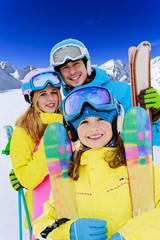 Ski - young skiers enjoying winter holidays