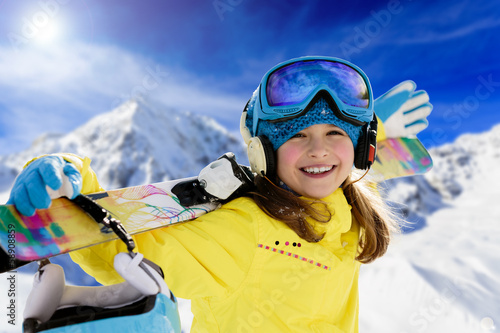Ski, winter fun - lovely skier girl enjoying ski holiday
