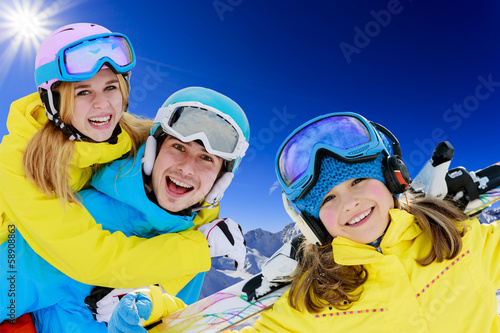Ski, winter - young skiers enjoying ski holidays