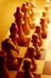 Chess pieces in yellow ambient light