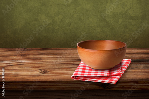 Tablecloths and soup bowl over wooden table