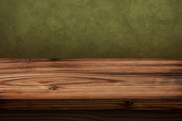 Old wooden table with green background