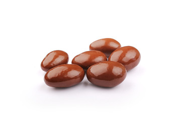Dark brown dragee, in chocolate covered