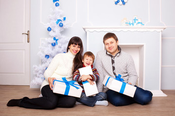 Funny family holding gifts. Christmas concept.