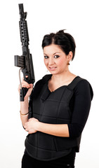 Young girl with black gun and paintball equipment