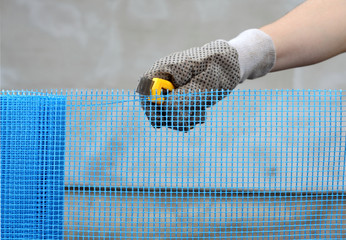 Worker hand cut mesh for styrofoam insulation