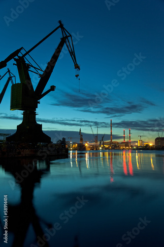 Night in shipyard of Gdansk, Poland. - 58914414