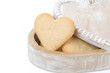 wooden box with cookies in the form of heart, isolated