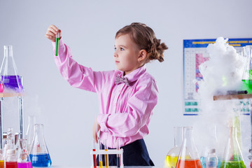 Stylish schoolgirl posing in chemistry lab