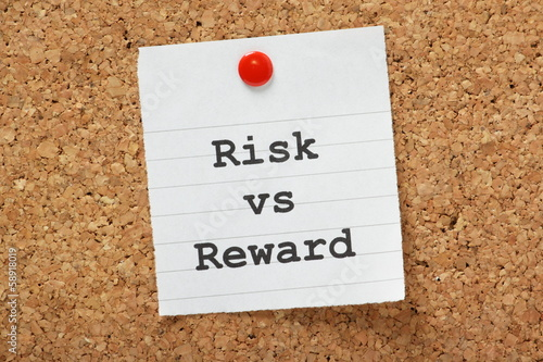 Risk Versus Reward Cork Notice board concept