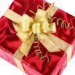 Pfiffige Geschenkpackung mit goldener Schleife