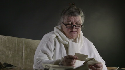 Senior woman looking at old photographs