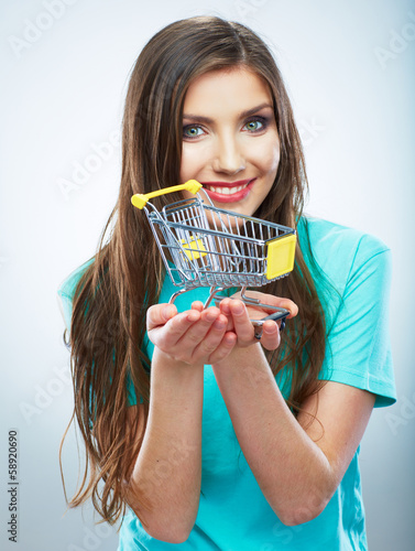 Portrait of happy smiling woman hold shopping cart. Female mod