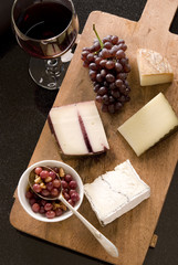 cheese board with pickled grapes