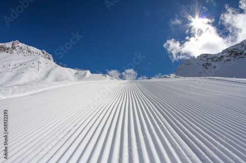 Foto op Canvas Wintersporten Fresh snow groomer tracks on a ski piste