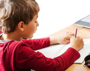 boy writing indoors